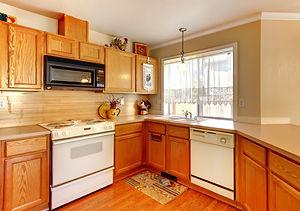 Wood and beige wall American standard ki