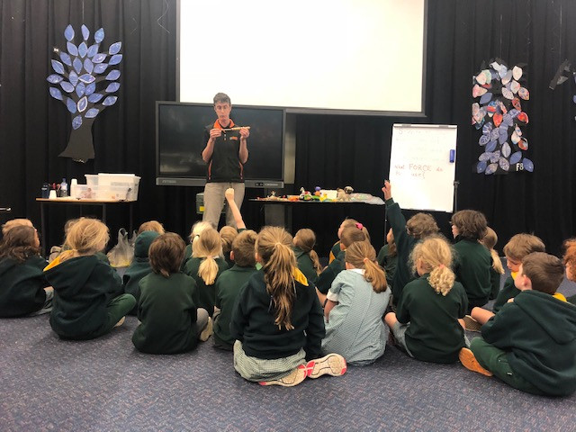 Students listening to Charlie from 'Hands on Science'.