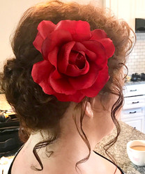 Updo with rose and tendrils