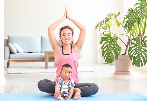 namaste hands over baby on mat.jpg