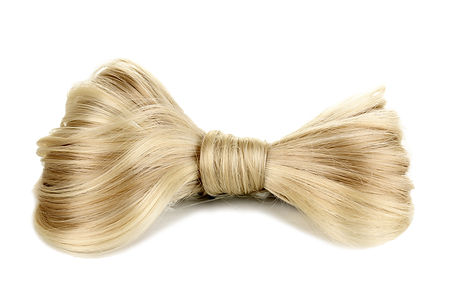 Shiny blond hair-pin isolated on white.j