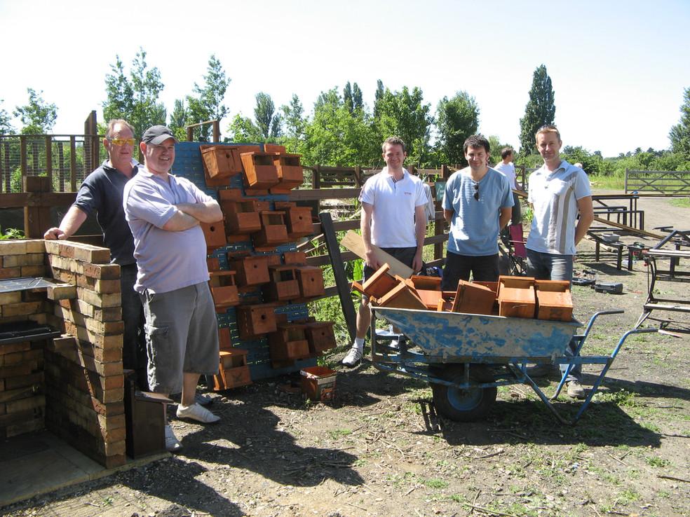 Volunteers build nest boxes.JPG