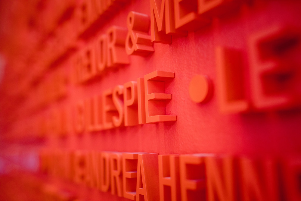 Rows of sans serif letters in red on a bold red backdrop, image by Jason Leung