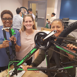 Volunteers Build Bikes for Foster Care Agency