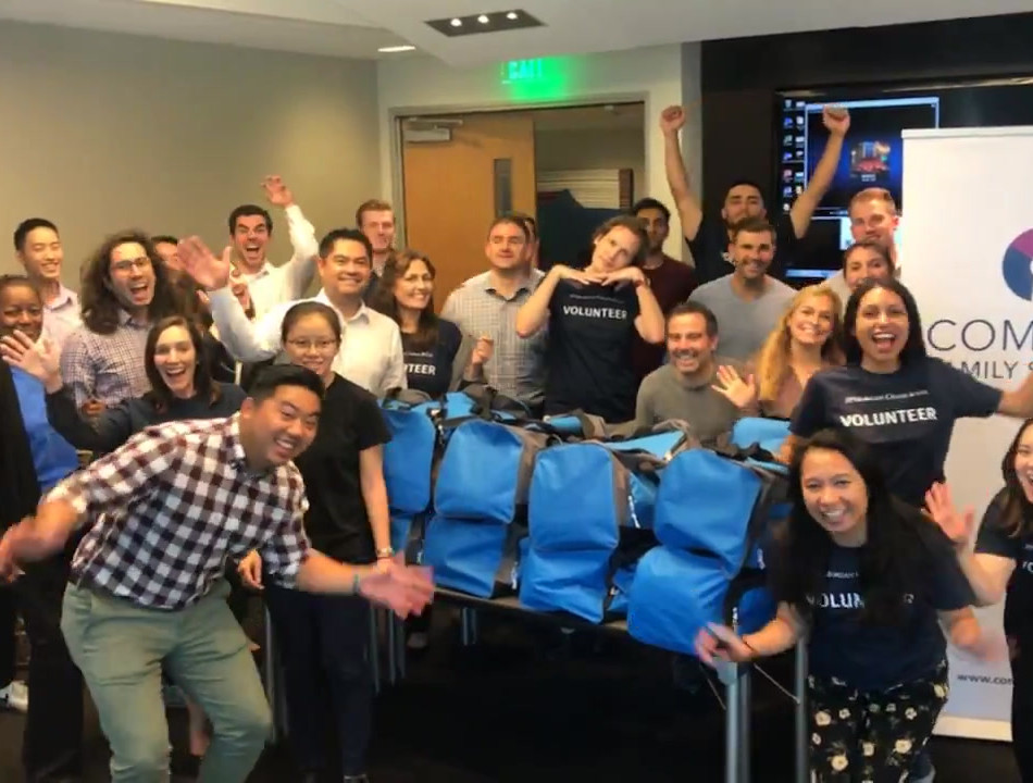 Corporate Volunteers Assemble Foster Care Bags
