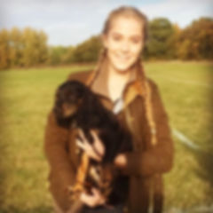 Driscoll therapy veterinary physiotherapy and human therapy business owner holding spaniel puppy