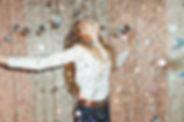 girl standing in glitter and stars.jpg
