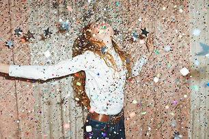 girl standing in glitter and stars.jpg