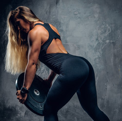 Blonde woman lifting plate.jpg