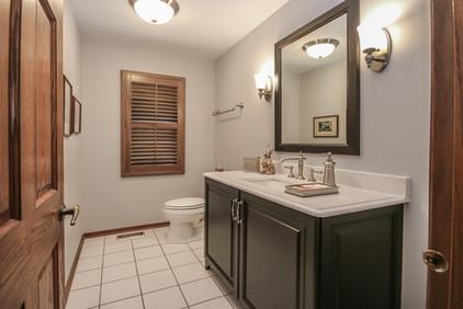 New basement half bathroom with vanity and toilet