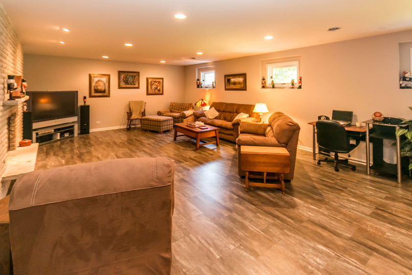 Finished basement turned into a living space with hardwood floors