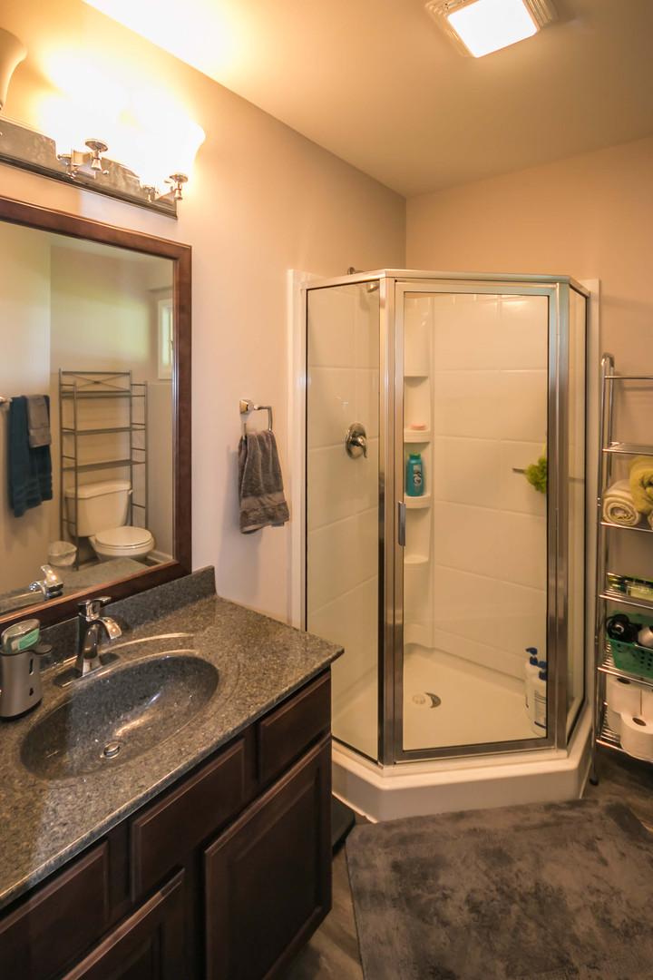 Corner shower installed in a basement bathroom remodel