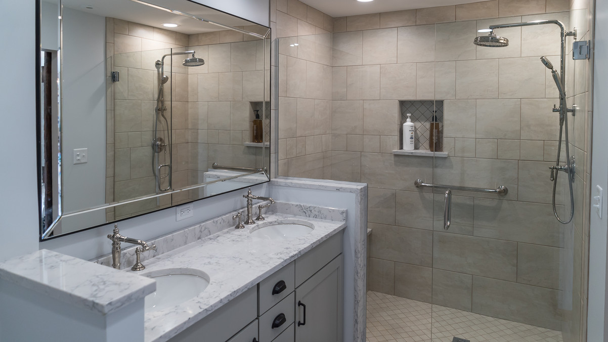Two bathroom sinks and a large shower
