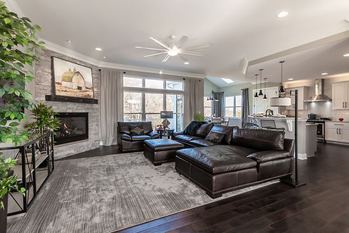 Family room with open floor plan, brick fireplace custom standard inclusions