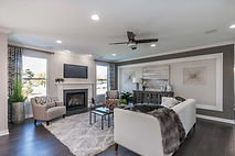 Large family room with furniture and fireplace