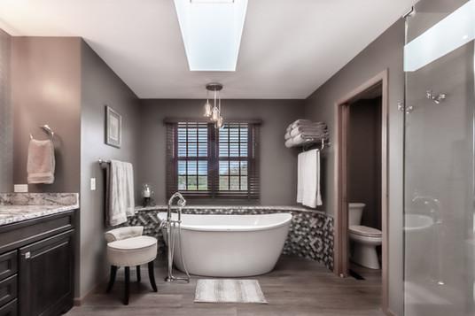 Luxury master bathroom with large tub