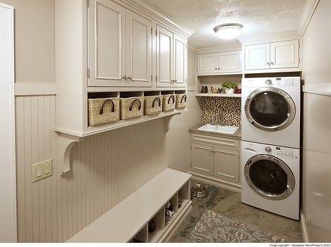 Laundry room remodeled with white cabinetry