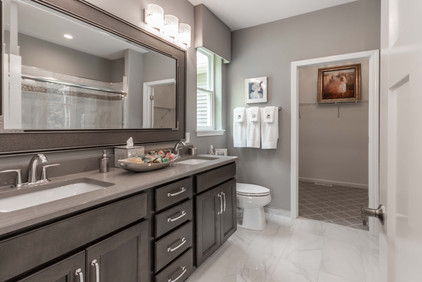 Bathroom renovation with his and her sinks and large mirror