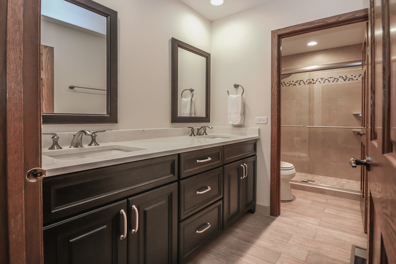 Libertyville bathroom vanity with dark cabinetry