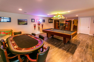 Game room with pool and card table