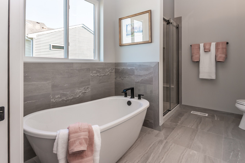 Large bathtub and new bathroom floors