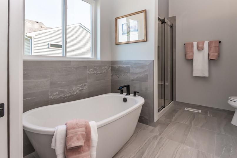 Large bathtub and new bathroom floors