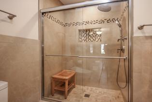 Libertyville walk in shower with glass sliding door