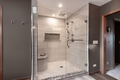 Walk in shower with sliding glass doors
