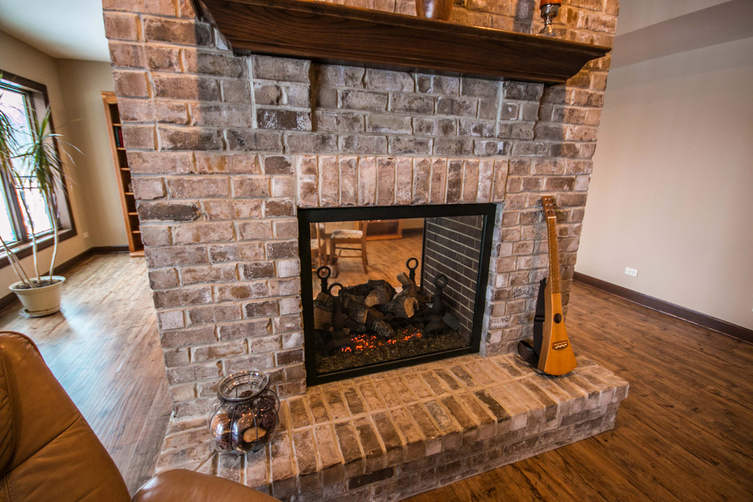 Double sided fireplace in a newly finished basement