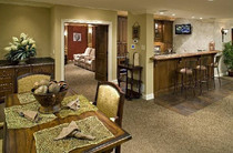 Comfy basement remodel with bar and movie theater room