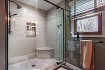 Large walk in shower with corner bench