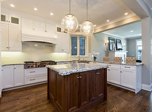 Large custom home kitchen with island and hanging ball lights