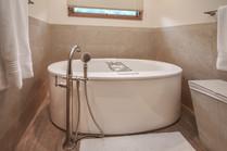 Large bath tub with movable bath faucet head
