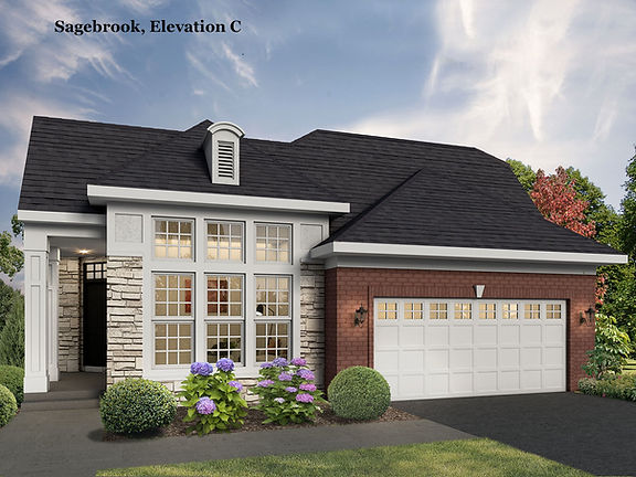 Custom home exterior with exposed brick and two car garage