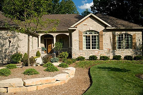 Brentwood custom ranch home with brick exterior and creative landscaping