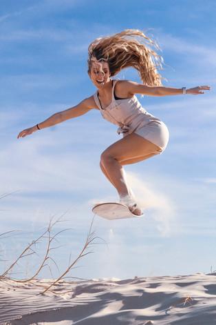 payton-sandboarding-midair.jpg