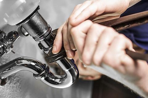 Plumber Fixing Leak, Viking Plumbing