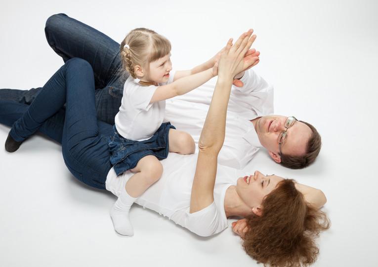 casal e a sua filha fotografadas