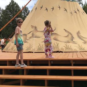 Children visiting the tipis