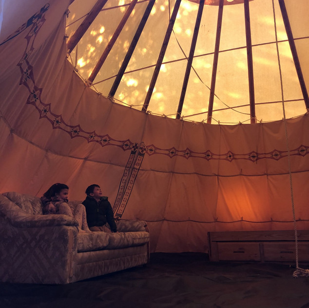 Young visitors checking out the new tipis