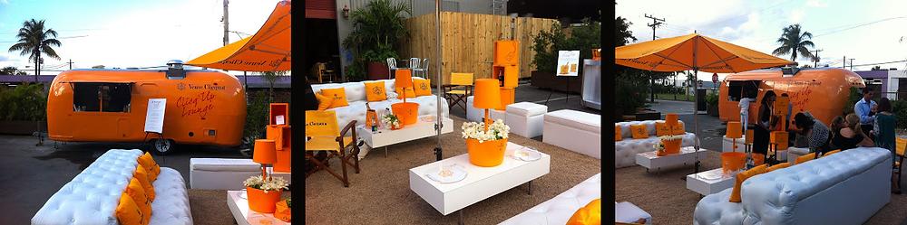 MARQUE : Veuve Clicquot • Champagne  ÉVÉNEMENT : Art Basel Miami CONCEPT : Création d'un lounge extérieur Veuve Clicquot dans une aire de stationnement du district, le CLICQ'UP LOUNGE DESIGN : Un AIRSTREAM restauré servant du champagne froid et désaltérant dans de belles coupes. Un miracle au milieu de nulle part! DURÉE : Pendant le festival. Le concept se déplace facilement d'un endroit à l'autre depuis 2 ans.
