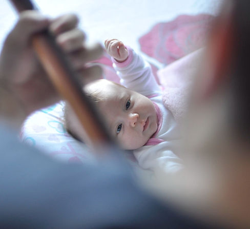 baby listening to guitar_edited.jpg