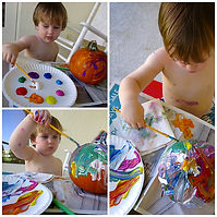 kid painting a pumpkin.jpg