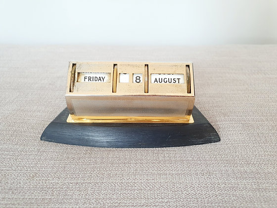 Brass Perpetual Calendar on Wooden Base