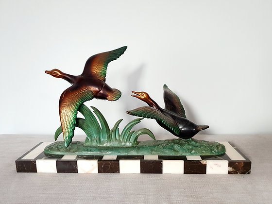 Spelter Ducks on Chequerboard Marble