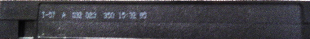 "The bottom of the cassette for the 1995 release of ""Thomas and His Friends Help Out."" The cassette/print-date-info appears to read ""T-57 A 032 023 350 15:32 95."""