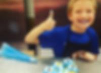 cupcake decorating boy.jpg
