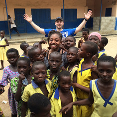 Hanging with the beautiful children while supporting a project in Ghana