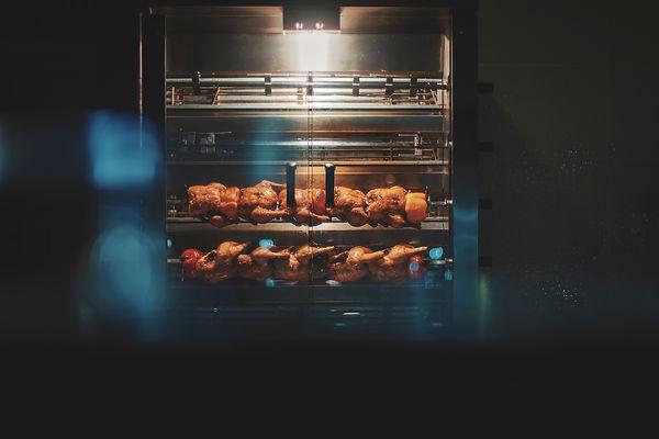Chicken roasting in commercial rotisseri