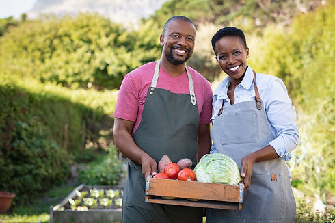 Portrait of happy black farmer couple ho